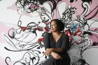 """Artist Shinique Smith seated in front of her 2008 work """"Especially In The Afternoon."""" (Courtesy Keith Bedford/Museum of Fine Arts, Boston)"""