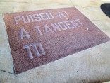 """POISED AT A TANGENT TO.."" middle rectangle on sidewalk"