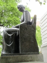 The sculptor - herself a Quaker—has depicted Dyer in a reserved pose with no adornment. ""