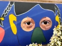 These eyes - the entire mural - belong to people who may never meet one another, but who already share a bond by walking the same sidewalk, sitting on the same bench, or buying bananas in the same store!