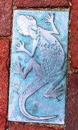 bronze tablet inlaid in bricks