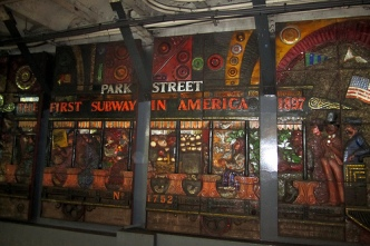 """.. the 12-ton, 110-foot-long cement mosaic in the Park Street subway station"
